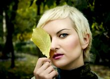 Portrait of the young woman with tree sheet Royalty Free Stock Images