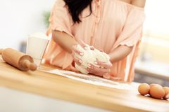 Young woman trying to cook something in kitchen. Portrait of young woman trying to cook something in kitchen Royalty Free Stock Image
