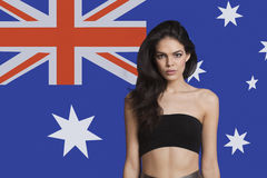 Portrait of young woman in tube bra against Australian flag Royalty Free Stock Photo