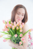 Portrait of young woman with  tulips Stock Images