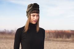 Portrait of young woman with turban in desert. Portrait of young woman with turban royalty free stock image