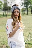 Portrait of young woman with turban on head and posing outdoor royalty free stock image