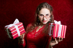 Portrait of a young woman with two striped gifts. Stock Images