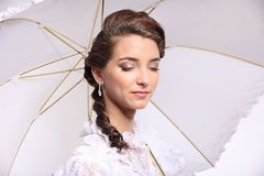 Portrait of young woman with umbrella retro wedding Stock Photo