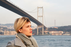 Portrait of a young woman under the Bosporus bridge. Portrait of a young woman under the Bosporus bridge Stock Images