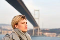 Portrait of a young woman under the Bosporus bridge. Portrait of a young woman under the Bosporus bridge Stock Photos