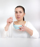 Portrait of young woman in underwear eating cereals.  Young woman eating cereal muslin (flakes) Stock Image