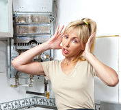 Portrait The young woman is upset by that the gas water heater has broken Royalty Free Stock Photo