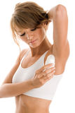 Woman using deodorant Stock Photo
