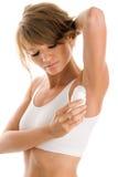 Woman using deodorant Stock Photo