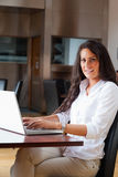 Portrait of a young woman using a laptop Stock Image