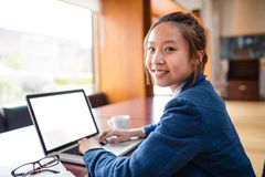 Portrait of young woman using laptop Royalty Free Stock Photography