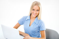 Portrait of young woman using laptop Stock Photos