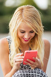 Portrait of young woman using phone Royalty Free Stock Photo