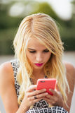 Portrait of young woman using phone Royalty Free Stock Photos