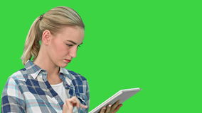 Portrait of a young woman using a tablet on a Green Screen, Chroma Key. stock video