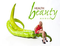 Portrait of a young woman with vegetables. Concept Royalty Free Stock Images