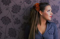 Portrait of young woman with victorian wallpaper Stock Photography
