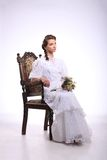 Portrait of young woman on vintage chair retro wedding Royalty Free Stock Image