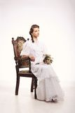 Portrait of young woman on vintage chair retro wedding Royalty Free Stock Photos