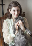 Young Woman in Antique Dress Holding Her Gray Cat Stock Images