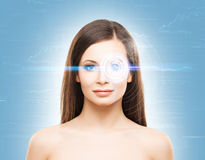 Portrait of a young woman with a virtual hologram Royalty Free Stock Image