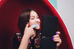 Portrait of young woman visiting dentist office for teeth whitening with photopolymer. stock image