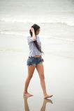 Portrait of a young woman walking on the beach alone Stock Photography