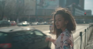 Portrait of a young woman walking in the city streets. stock video