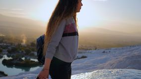 Young woman walking in Pamukkale terraces. Portrait of young woman walking in Cotton Castle limestone terraces in Pamukkale Turkey during beautiful sunset stock video