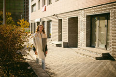 Portrait of young woman walking outdoors on warm autumn afternoon Stock Photos