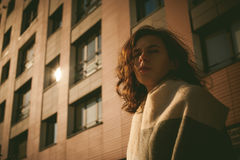 Portrait of young woman walking outdoors on warm autumn afternoon Royalty Free Stock Images