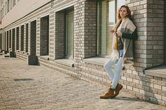 Portrait of young woman walking outdoors on warm autumn afternoon Royalty Free Stock Photos