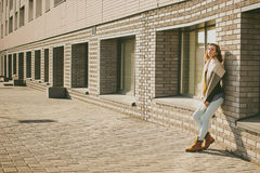 Portrait of young woman walking outdoors on warm autumn afternoon Royalty Free Stock Image