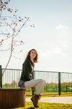 Portrait of young woman walking outdoors on warm autumn afternoon Stock Photography