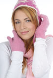 Portrait of a young woman in a warm winter hat Stock Photos