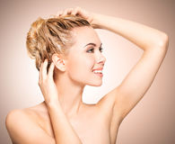 Portrait of an young woman washing her hair Royalty Free Stock Images