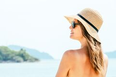 Free Portrait Young Woman Wearing A Straw Hat On Beach Royalty Free Stock Photography - 208368437