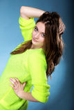 Attractive girl in bright vivid colour sweater Royalty Free Stock Photography