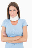 Portrait of a young woman wearing cervical collar. Over white background royalty free stock images