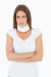 Portrait of a young woman wearing cervical collar. Over white background stock photos