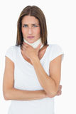 Portrait of a young woman wearing cervical collar. Over white background royalty free stock photo