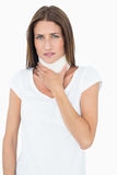 Portrait of a young woman wearing cervical collar. Over white background stock photo