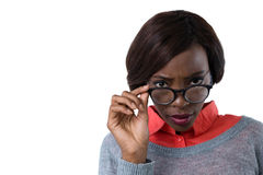 Portrait of young woman wearing eyeglasses. Against white background Royalty Free Stock Images