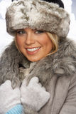Portrait Of Young Woman Wearing Fur Hat And Coat. Studio Portrait Of Young Woman Wearing Fur Hat And Coat Stock Photo
