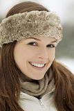 Portrait of a young woman wearing a fur headband, smiling Royalty Free Stock Image