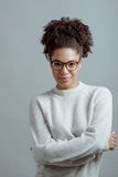Portrait of young woman wearing glasses. Against gray background Stock Photos