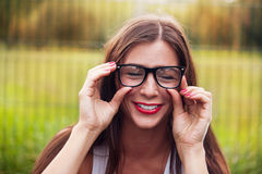 Portrait Of Young Woman Wearing Glasses On Playground Stock Images