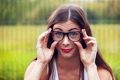 Portrait Of Young Woman Wearing Glasses On Playground Royalty Free Stock Images