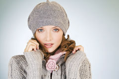 Portrait of a young woman wearing a grey woollen hat Royalty Free Stock Photos